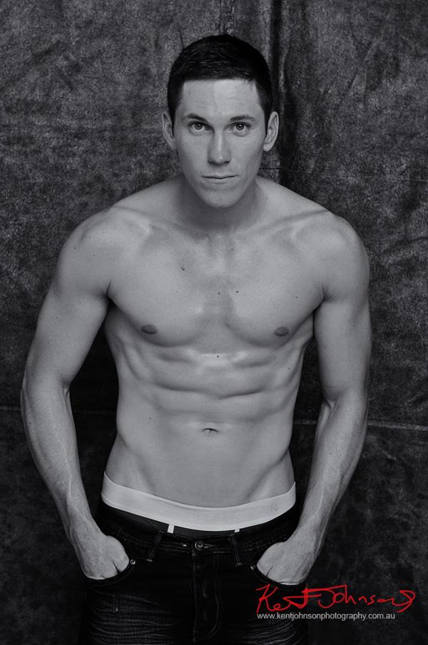 Fitness, muscle body shot in jeans; studio modelling portfolio by Kent Johnson.