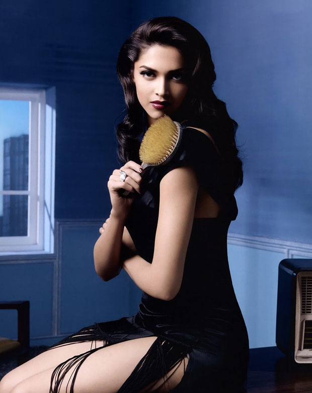 Deepika Padukone in a black dress with a handbrush -  Deepika Padukone HOT Vogue 2012 pics CONTINUED..