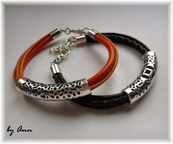 pomarańczowa i czarna bransoletka z rzemieni z ozdobnym elementem posrebrzzanym