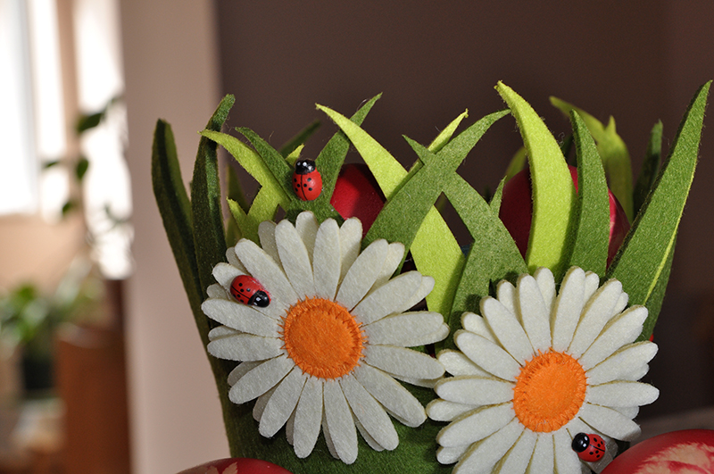 Little green basket with painted Easter-eggs