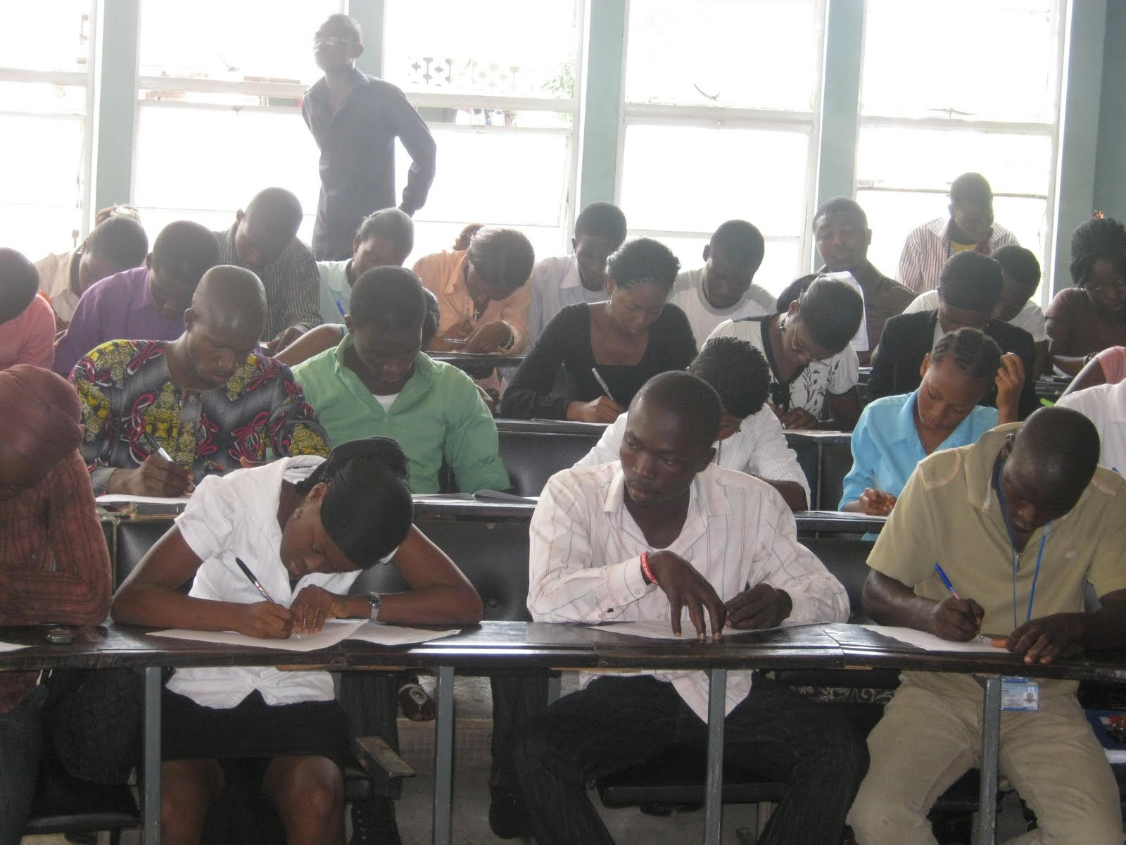 examination malpractice Inside the school hall in a typical nigerian examination centre, young men and women are seated with rapt attention as they listen to a middle aged, well built man,.