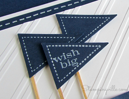 Petite pennants mounted on toothpicks