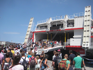 The large crowd boarding the ferry back to Athens.