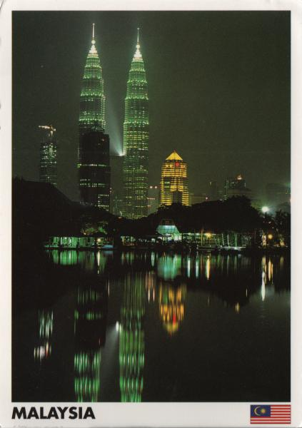 night view of the Petronas Towers and their reflections