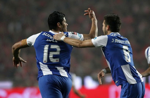 Hulk celebrates his goal against Benfica with his Porto team-mate João Moutinho