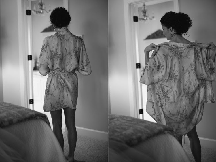 bride wearing custom floral robe as she gets ready for her wedding
