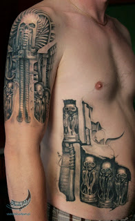Biomechanical gun tattoo