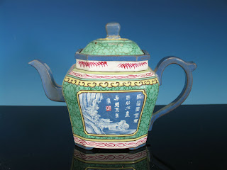 "<img src=""rare inscribed Yixing Teapotl .jpg"" alt=""decorated in famille enamels with rows of script"">"