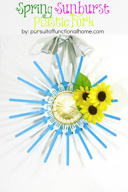 Spring Sunburst Plastic Fork. Torqouise and white forks, Yellow Sunflower and white buttons forming a circle in middle.