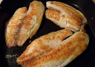 Three Pieces of Grilled Tilapia in Pan