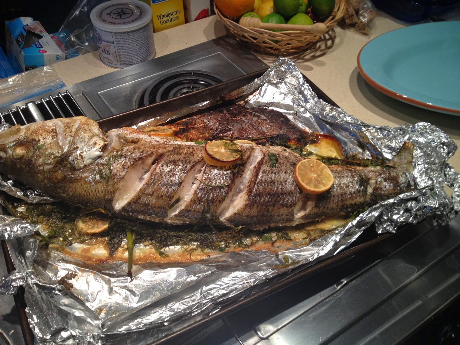 Corcoran street kitchen whole oven roasted rockfish for Fish in foil in oven