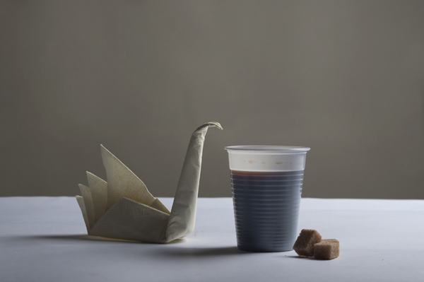 Origami bird and a cup coffee