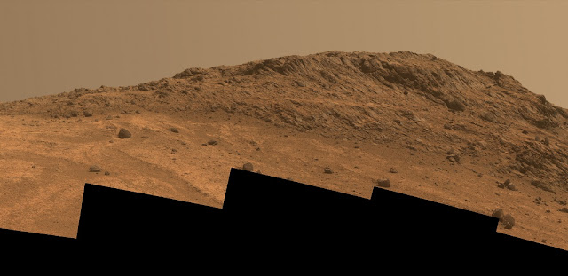 "This Martian scene shows contrasting textures and colors of ""Hinners Point,"" at the northern edge of ""Marathon Valley,"" and swirling reddish zones on the valley floor to the left. Credits: NASA/JPL-Caltech/Cornell Univ./Arizona State Univ."