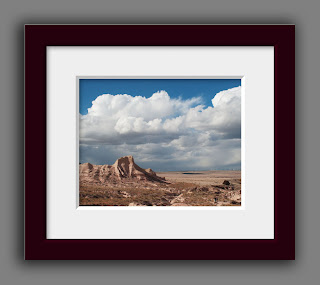 sandy rugged buttes rising under a dramatic stormy spring sky on the High Plains of Colorado