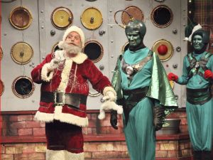 Santa and some Martians in Santa Claus Conquers the Martians http://movieloversreviews.blogspot.com/2012/12/santa-claus-conquers-martians-1964.html