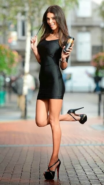 Stork pose in a little black dress and platform high heels