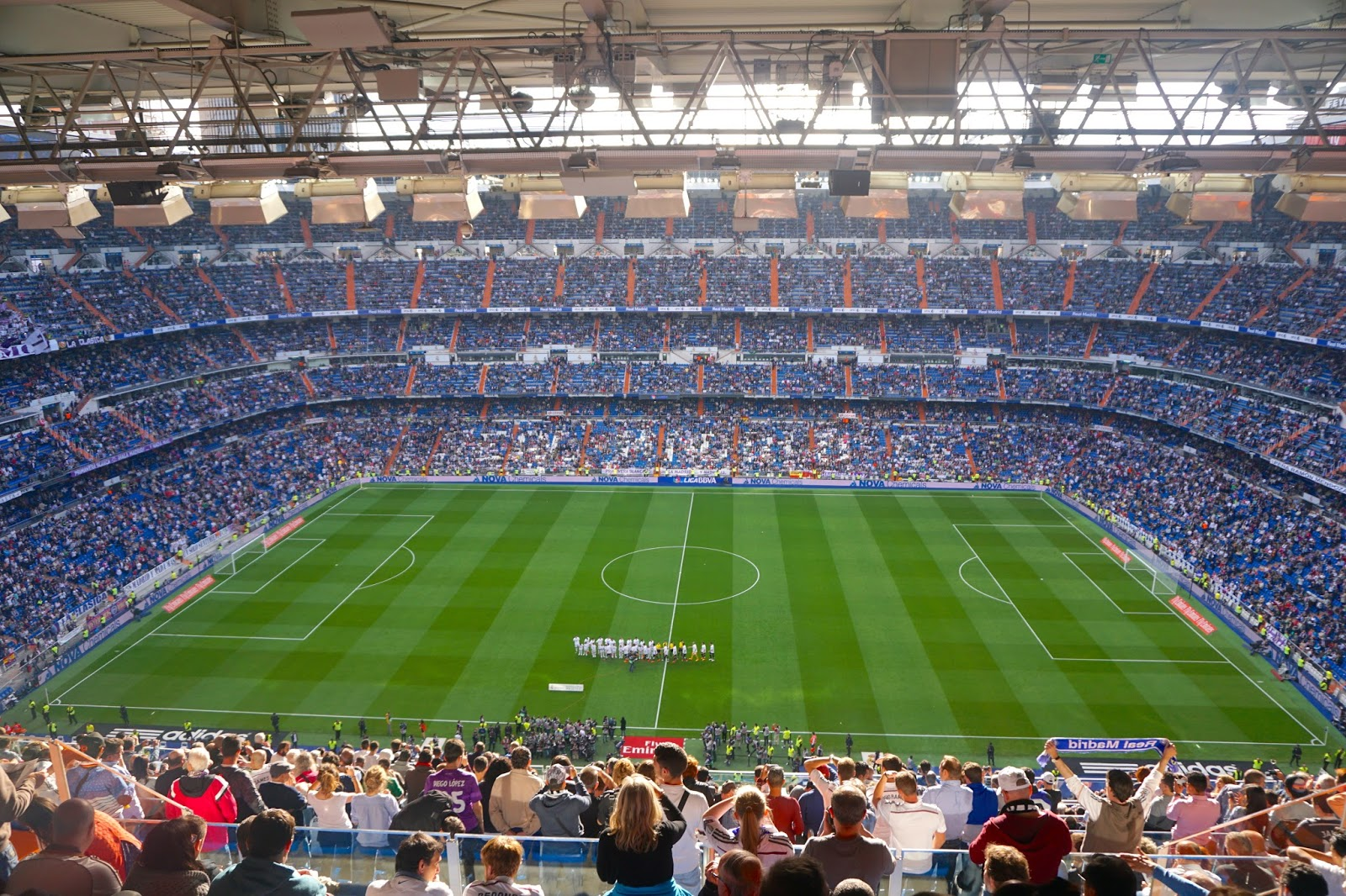 Football players lining up for the coin toss before a Real Madrid Match at Santiago Berbabeu Stadium