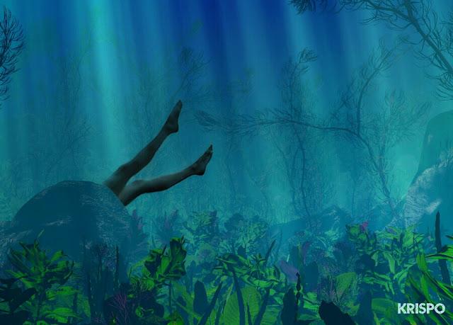 piernas tras roca de una mujer ahogada en el fondo del mar