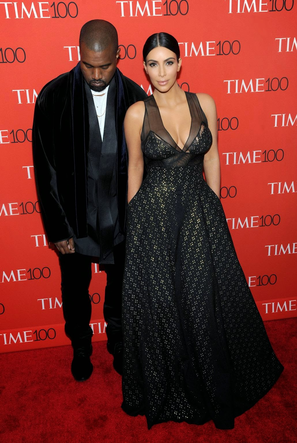 Kim Kardashian bares cleavage alongside Kanye West at the 2015 Time 100 Most Influential People in the World Gala