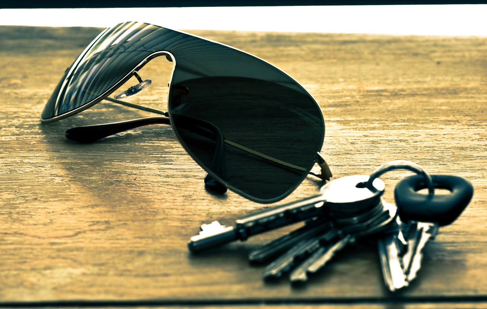 Sunglasses and keys on a table