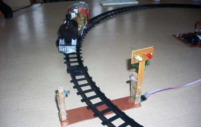 Automatic Railway Gate Control System Using AVR ATmega8  with complete project report, code and circuit diagram.