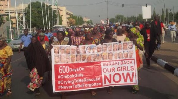 Chibok Girls: Parent Faints As 'Bring Back Our Girls' Protest Hits Aso Rock Villa