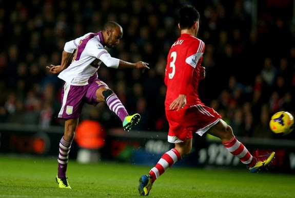 Aston Villa player Fabian Delph shoots to score the winning goal against Southampton