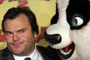 Jack Black posing next to a giant fake panda for Kung Fu Panda 2 animatedfilmreviews.filminspector.com