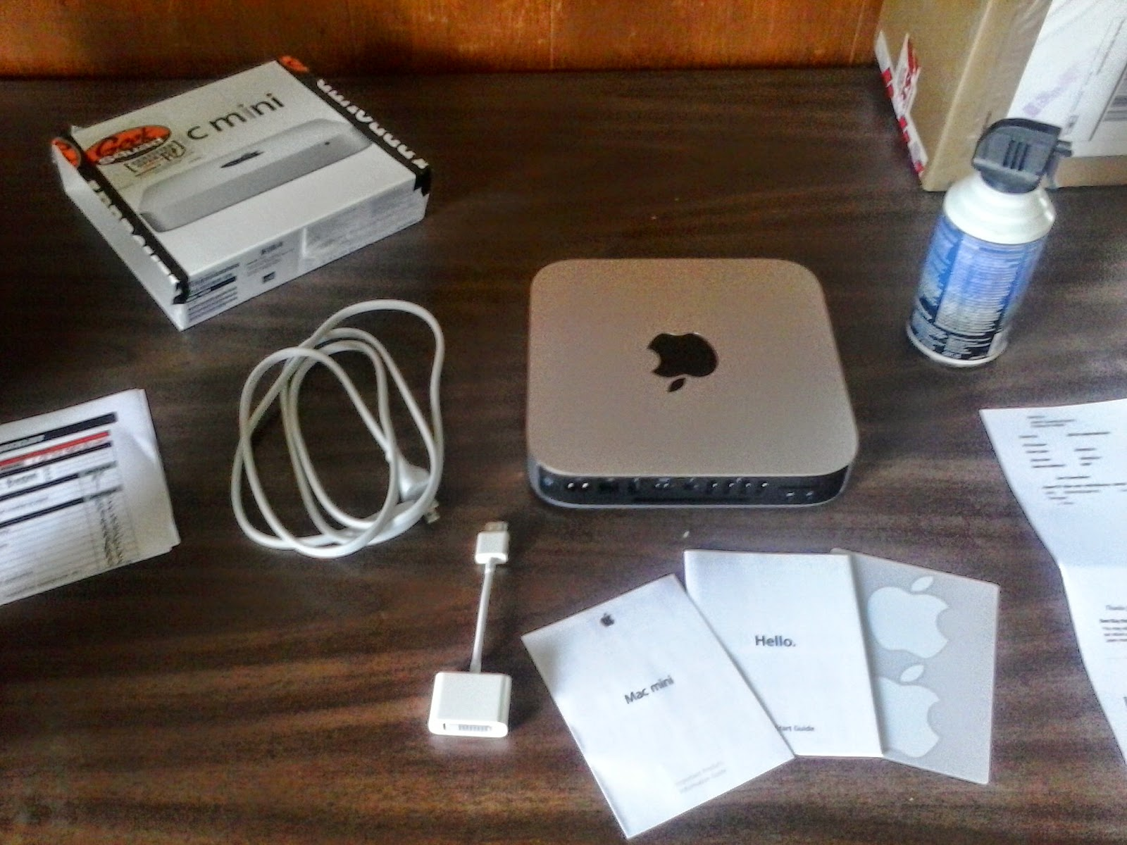 A MAC mini with all the stuff that comes with it. Key is that dongle which allows your monitor to hook up - and those nifty decals.