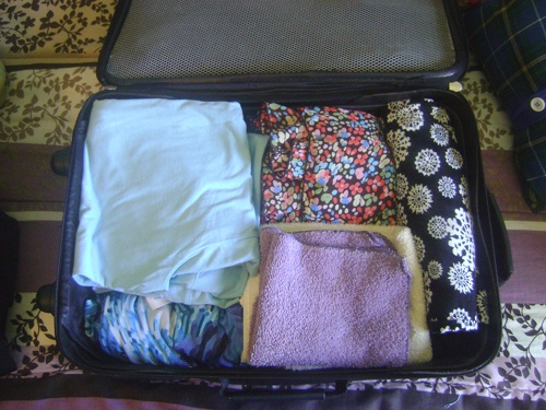 how to pack dress shirts in suitcase