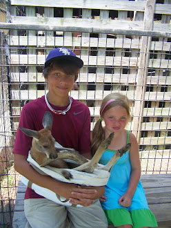 Christian and Bella holding a baby kangroo
