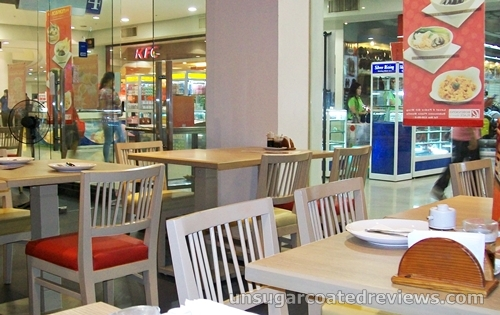 tables and chairs at Mongkok Dimsum & Noodles