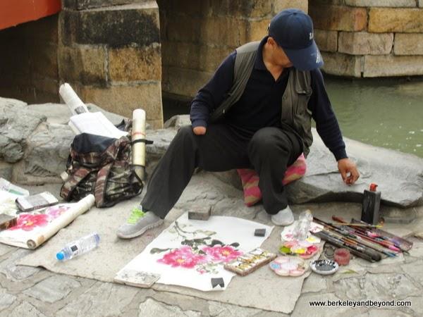 artist vendor at Summer Palace in Beijing, China