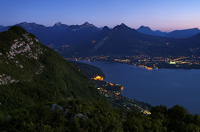 Photo of Annecy lake viewed from the mountains at dusk time