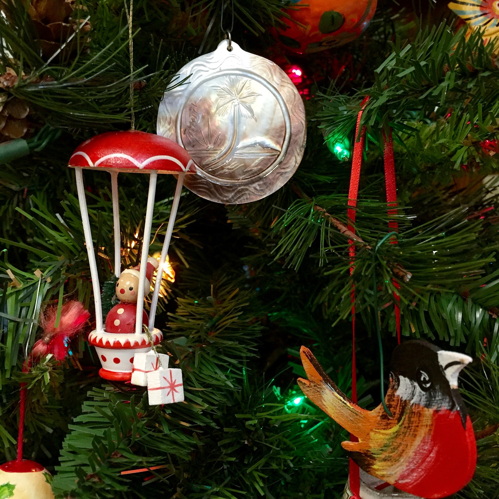 Christmas decoration all around the world - An Italian Hot Air Balloon Tahitian Palm Ornament And A Swedish Bird
