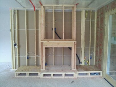 Built in fireplace entertainment center retro tech for Building an indoor fireplace