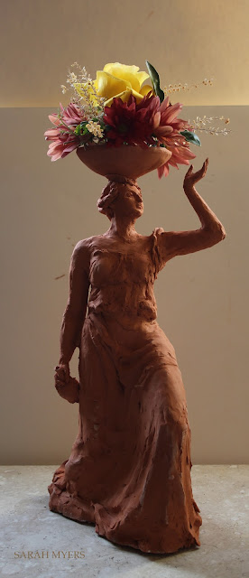 woman, sculpture, bowl, figure, terracotta, ceramic, earthenware, red, Sarah, Myers, flowers, lady, escultura, art, arte, clay, bottle, bouquet, rose, chrysanthemums, mums, yellow, orange, new, artwork, classic, figurative, renaissance, artist, tall, beautiful, spontaneous, kunst, move, walk, stride, arrangement, decor, deco