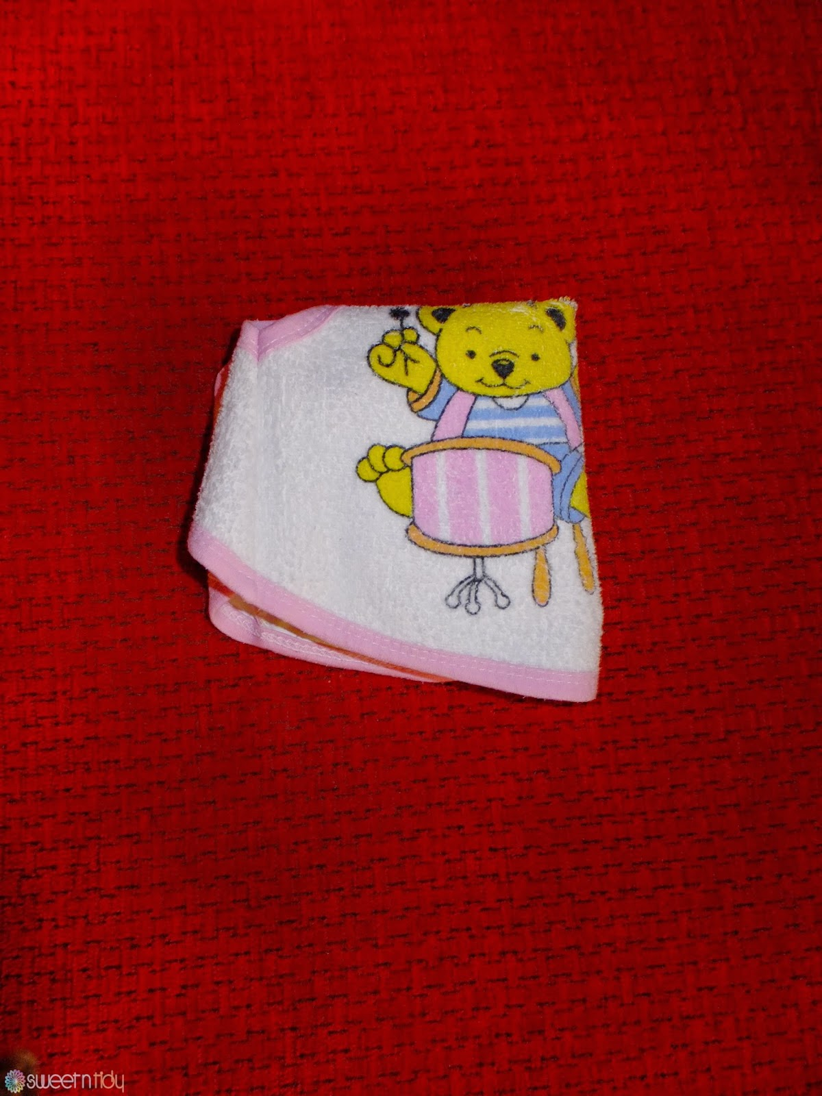 How to fold baby clothes