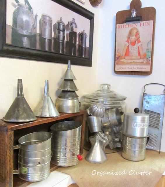 An Industrial Look Kitchen with Tin and Aluminum Utensils www.organizedclutterqueen.blogspot.com