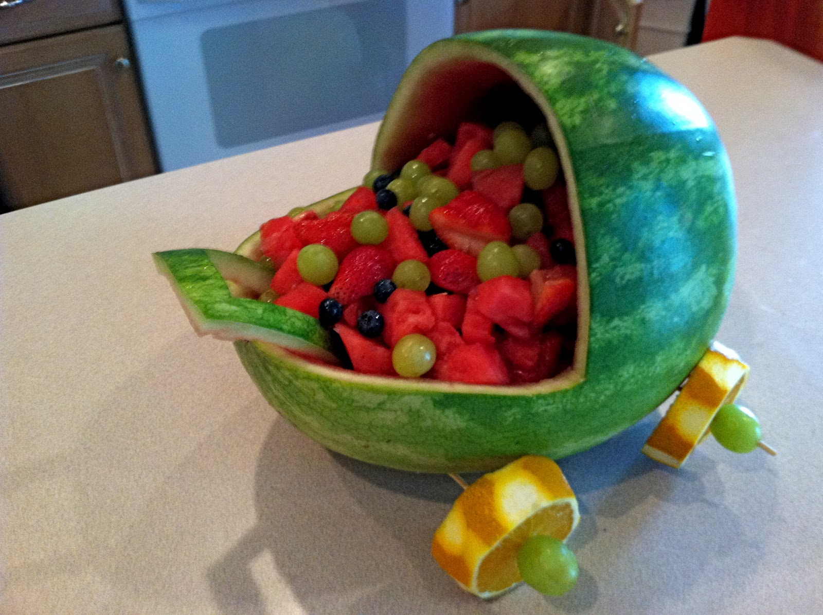 A simple touch baby shower decorations for Baby shower fruit decoration ideas