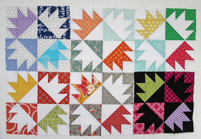 quilts blocks featuring the chicken foot pattern in multiple color shcemes