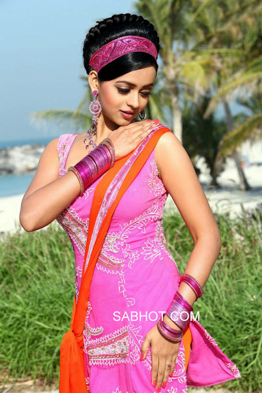 Bhavana in pink 70's Suit Dress - Bhavana in Pink 70's Dress from Asal Movie
