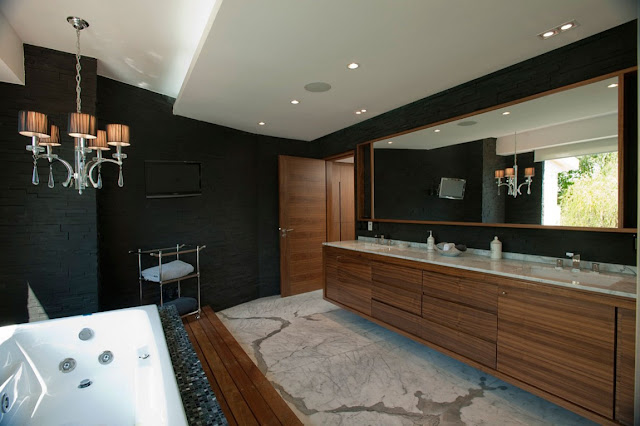 Modern bathroom with black walls and wooden furniture