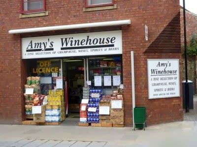 http://www.funnysigns.net/amys-winehouse/