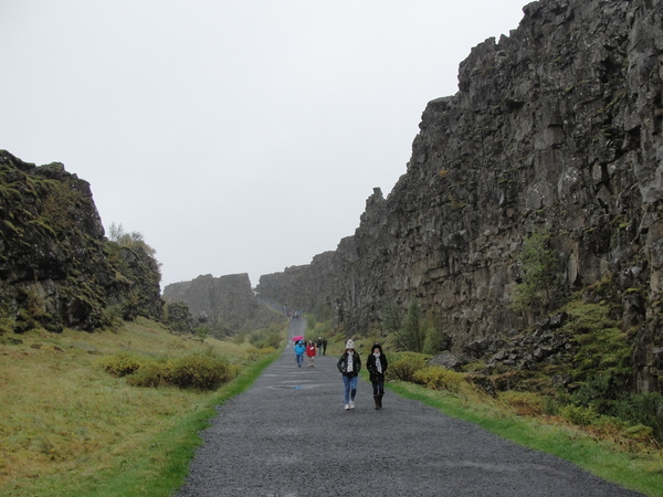 walking between tectonic plates in Þingvellir national park on Iceland Golden Circle tour