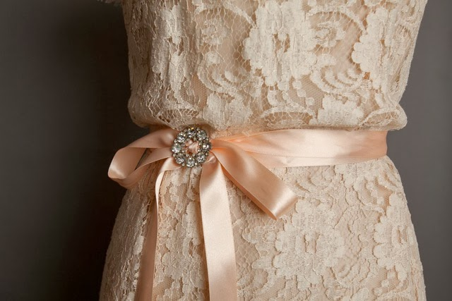 Pastel lace vintage wedding dresses, detail of pastel lace and sash with crystal