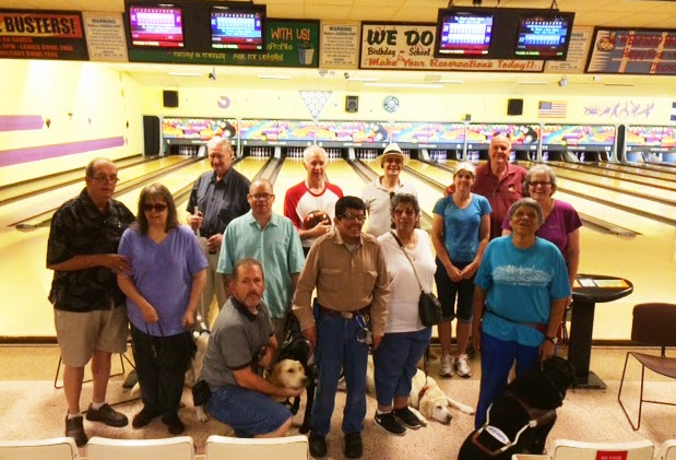 Members from the Rocky Rovers GDB alumni chapter pose with their guides (in the background are the bowling lanes).