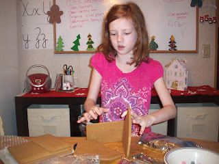 Assembling a gingerbread hous
