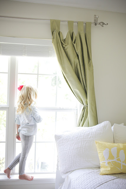 Little blonde girl waiting in window