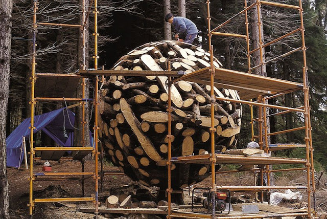 Large Globes of shaped Wood Logs